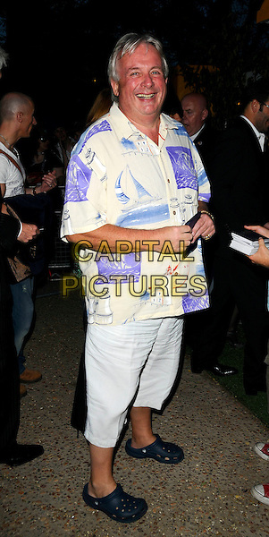 "CHRISTOPHER BIGGINS.The ""Mamma Mia!"" world premiere afterparty, the FQEvents Marquee, Upper Ground, London, England..June 30th, 2008.after party full length white cropped trousers purple print shirt blue .CAP/CAN.©Can Nguyen/Capital Pictures."