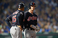 Cleveland Indians Tyler Naquin (30) talks with first base coach Sandy Alomar Sr. (15) in the second inning during Game 4 of the Major League Baseball World Series against the Chicago Cubs on October 29, 2016 at Wrigley Field in Chicago, Illinois.  (Mike Janes/Four Seam Images)
