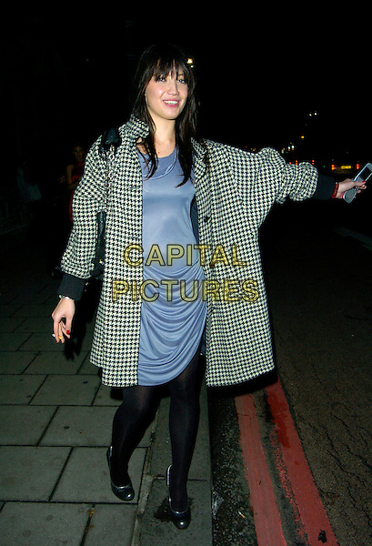 DAISY LOWE.Links of London - watch launch event, Il Bottaccio, Grosvenor Place, London, England..September 25th, 2007.full length blue dress black white checkered coat mobile phone tights hailing cab taxi arm outstretched .CAP/CAN.©Can Nguyen/Capital Pictures