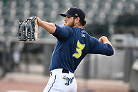 Right fielder Arnaldo Berrios (3) of the Columbia Fireflies warms up before a game against the Charleston RiverDogs on Monday, August 7, 2017, at Spirit Communications Park in Columbia, South Carolina. Columbia won, 6-4. (Tom Priddy/Four Seam Images)