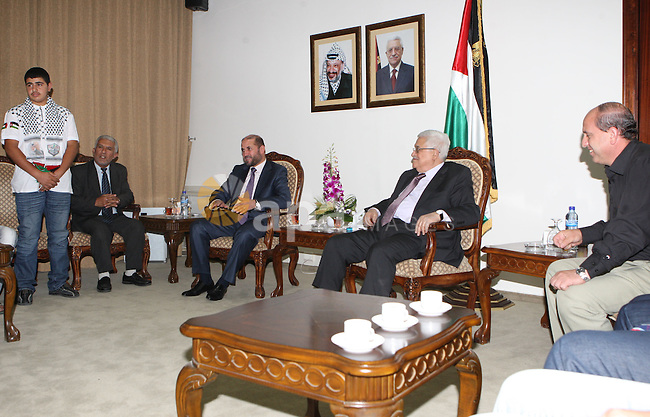 Palestinian President Mahmoud Abbas during a meeting with the sons of martyrs and wounded of Gaza at the Palestinian President headquarters in the West Bank city of Ramallah on June 30, 2010. Photo by Thaer Ganaim