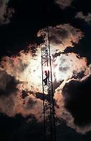 Doug Buzzell climbing a radio antenna we used to climb, 1987.&amp;#xA;<br />