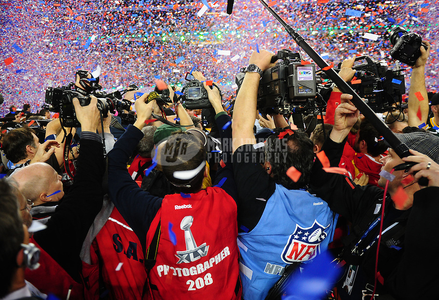 Feb 6, 2011; Arlington, TX, USA; Photographers and members of the media rush the field in the post game scrum following Super Bowl XLV between the Green Bay Packers against the Pittsburgh Steelers at Cowboys Stadium.  Mandatory Credit: Mark J. Rebilas-