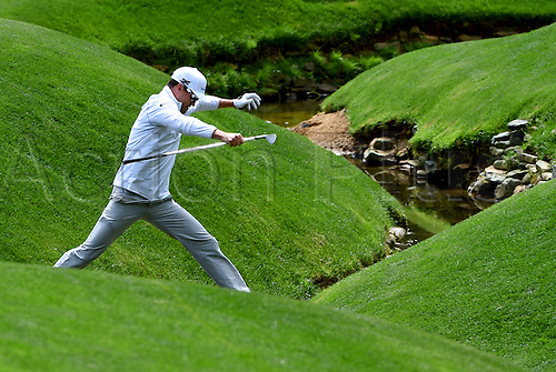 06.04.2016. Augusta, GA, USA. Zach Johnson jumps over a stream at the 13th green during a practice round on Wednesday, April 6, 2016, at Augusta National Golf Club in Augusta, Ga. First round action of The Masters tournament begins on Thursday