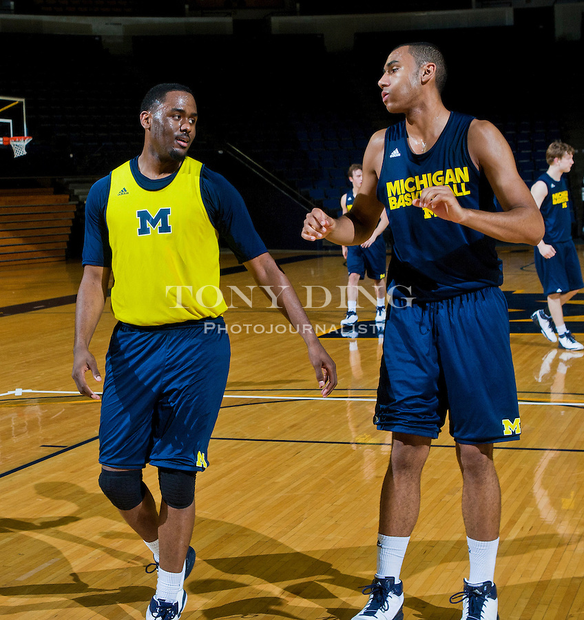 Michigan guard Jordan Dumars, left, and forward Jon Horford, right, during a team practice, Thursday, Nov. 11, 2010, at Crisler Arena in Ann Arbor, Mich. Dumars is the son of former Detroit Pistons All-star and current President of Pistons Basketball Joe Dumars, and Horford is the son of former Milwaukee Bucks' Tito Horford and brother to the Atlanta Hawks' Al Horford. (AP Photo/Tony Ding)