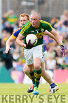 Kieran Donaghy Kerry in Action against George Hannigan Tipperary in the Senior Munster Football Final at Fitzgerald Stadium, Killarney on Sunday.