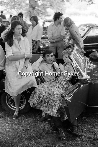 Eton, Berkshire. 1978<br /> The Fourth of June at Eton College, a day of celebrations, rowing on the river, inter-house cricket matches and a chance for old scholars to turn up, sporting new girlfriends.