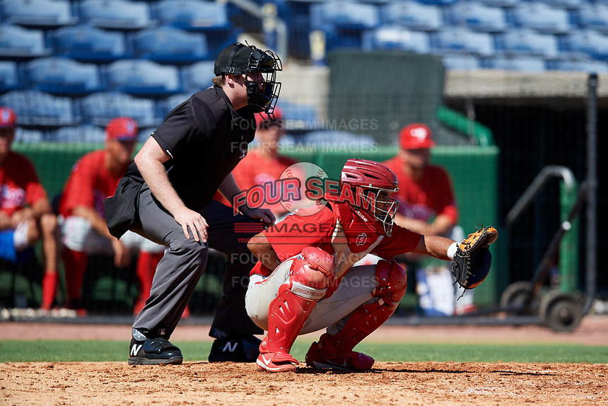 Philadelphia Phillies catcher Freddy Francisco (6) waits to receive a pitch in front of home plate umpire Mitch Leikam during a Florida Instructional League game against the New York Yankees on October 12, 2018 at Spectrum Field in Clearwater, Florida.  (Mike Janes/Four Seam Images)