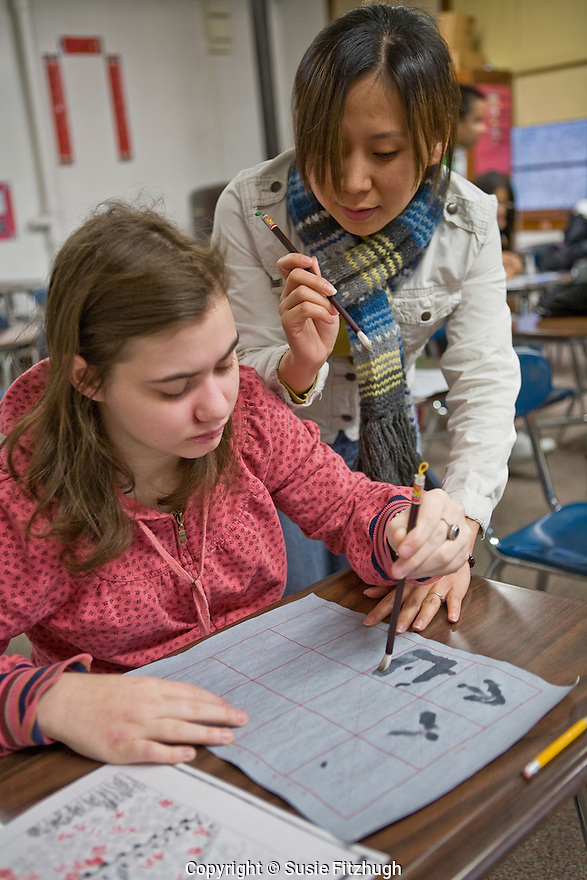 Zhu Dan leads her Chief Sealth HS students in learning Chinese Calligraphy.