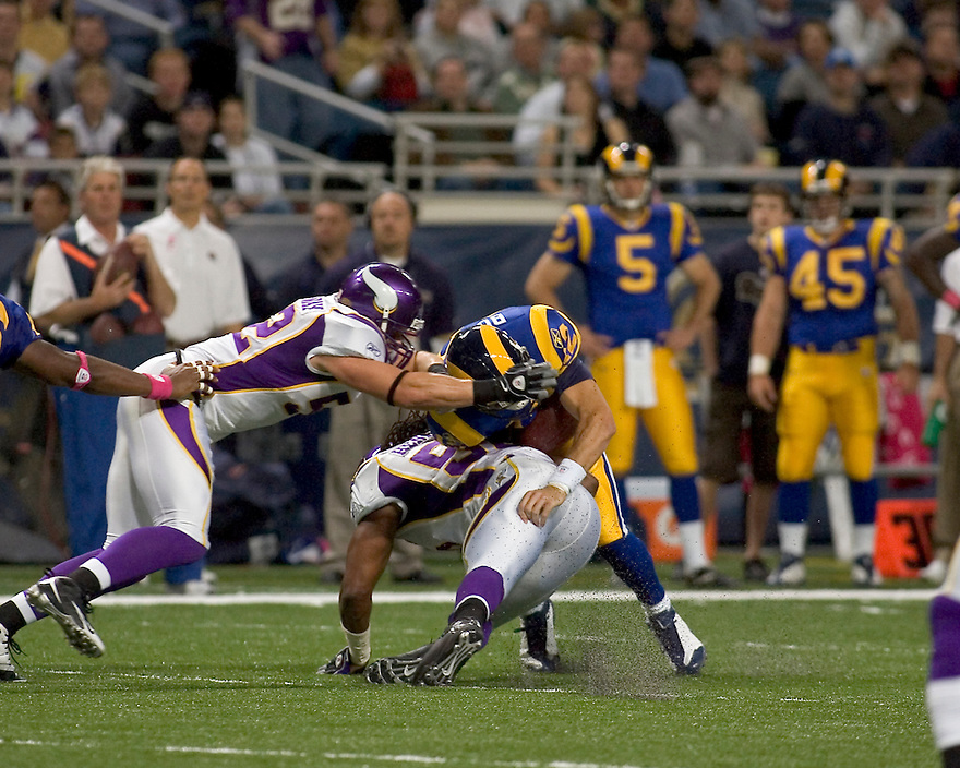 October 11, 2009 - St Louis, Missouri, USA - Rams quarterback Kyle Boller (12) is sacked in the game between the St Louis Rams and the Minnesota Vikings at the Edward Jones Dome.  The Vikings defeated the Rams 38 to 10.  .