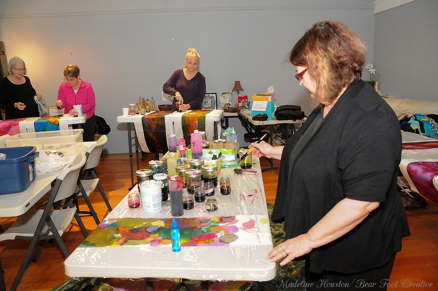 Artist Jan Nontell participates in a silk scarf painting class led by artist Sue Wachter at the Rectangle Gallery.<br />