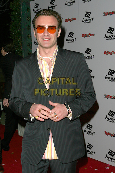 JULIAN McMAHON.Kanye West  Post Grammy Party hosted by Boost Mobile and Dave Meyers. Los Angeles, California..February 13th, 2005.Photo Credit: Zach Lipp/AdMedia.half length pinstripe suit jacket sunglasses shades striped shirt rings fashion disaster.www.capitalpictures.com.sales@capitalpictures.com.© Capital Pictures.