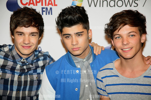 Liam Payne, Zayn Malik and  Louis Tomlinson from One Direction at The Jingle Bell Ball, The O2 Arena, east London. 04/12/2011  Picture by: Alexandra Glen / Featureflash