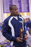 Michael Ashley on the award stand with his 8th place trophy in the 400 meters.