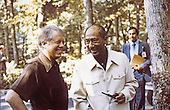 United States President Jimmy Carter, left, and President Anwar Sadat of Egypt, right, appear relaxed as they prepare for the summit talks with Prime Minister Menachem Begin of Israel at Camp David, the presidential retreat near Thurmont, Maryland on September 6, 1978..Credit: White House via CNP
