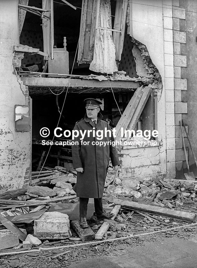 Policeman on duty outside the Imperial Bar, Stewartstown, Co Tyrone, N Ireland, UK, following the previous day&rsquo;s no warning bomb attack on 3rd February 1972 in which one man died. The victim, Louis O&rsquo;Neill, 49 years, Roman Catholic, married with six children, was drinking in the Roman Catholic-owned bar which was ostensibly closed, along with other bars, out of respect for Bloody Sunday victims. There was speculation that the bombing was carried out by the IRA because the bar had not closed completely. However the bombing fitted the pattern of loyalist attacks in and around Co Tyrone at the time. 197203040094<br />