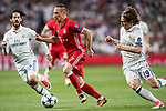 Franck Ribery (C) of FC Bayern Munich competes for the ball with Luka Modric (R) of Real Madrid during their 2016-17 UEFA Champions League Quarter-finals second leg match between Real Madrid and FC Bayern Munich at the Estadio Santiago Bernabeu on 18 April 2017 in Madrid, Spain. Photo by Diego Gonzalez Souto / Power Sport Images