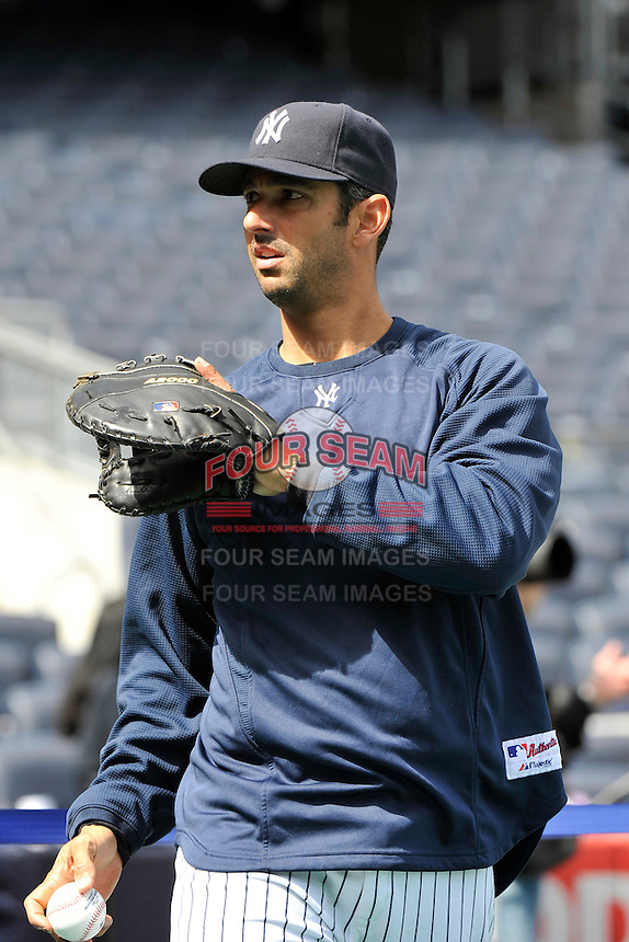 Apr 02, 2011; Bronx, NY, USA; New York Yankees catcher Jorge Posada (20) before game against the Detroit Tigers at Yankee Stadium. Yankees defeated the Tigers 10-6. Mandatory Credit: Tomasso De Rosa