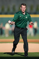 Charlotte 49ers men's basketball head coach Mark Price pretends to dribble the ball towards home plate prior to the game against the North Carolina State Wolfpack at BB&T Ballpark on March 31, 2015 in Charlotte, North Carolina.  The Wolfpack defeated the 49ers 10-6.  (Brian Westerholt/Four Seam Images)