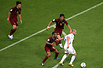 05 July 2006: Portugal uses a layered approach to try to contain Zinedine Zidane (FRA) (right).  Costinha (POR) (6) is closest, Meira Fernando (POR) (5) comes to help, and Nuno Valente (POR) (14) holds position behind them. France defeated Portugal 1-0 at the Allianz Arena in Munich, Germany in match 62, the second semifinal game, in the 2006 FIFA World Cup.