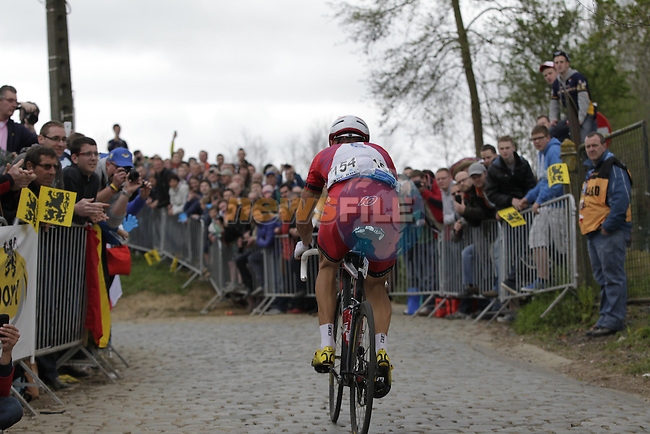 Aliaksander Kuchynski Katusha climbs the Oude Kwaremont for the 2nd time during the 2014 Tour of Flanders, Belgium.<br /> Picture: Eoin Clarke www.newsfile.ie