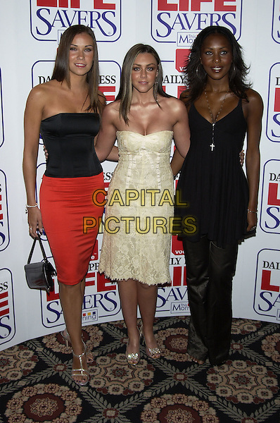JESSICA TAYLOR, MICHELLE HEATON & KELLI YOUNG.Vodafone Life Savers Awards, Savoy Hotel, The Strand, London, November 11th 2004..full length Libety X strapless black top red skirt cream dress black dress kelly.Ref: PL.www.capitalpictures.com.sales@capitalpictures.com.©Capital Pictures.