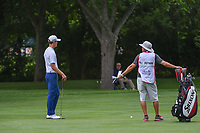 Andrew Putnam (USA) takes an extended amount of time discussing his approach shot with his caddie on 7 during round 4 of the 2019 Charles Schwab Challenge, Colonial Country Club, Ft. Worth, Texas,  USA. 5/26/2019.<br /> Picture: Golffile | Ken Murray<br /> <br /> All photo usage must carry mandatory copyright credit (© Golffile | Ken Murray)