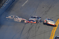 Feb 7, 2009; Daytona Beach, FL, USA; ARCA RE/MAX Series drivers Bill Baird (52) Benny Chastain (75) and Peyton Sellers (47) crash during the Lucas Oil Slick Mist 200 at Daytona International Speedway. Mandatory Credit: Mark J. Rebilas-