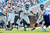 Sept 11, 2011:   Jacksonville Jaguars quarterback Luke McCown (12) takes a snap while offensive tackle Eugene Monroe (75) blocks during first half action between the Jacksonville Jaguars and the Tennessee Titans at EverBank Field in Jacksonville, Florida. Jacksonville defeated Tennessee 16-14.........