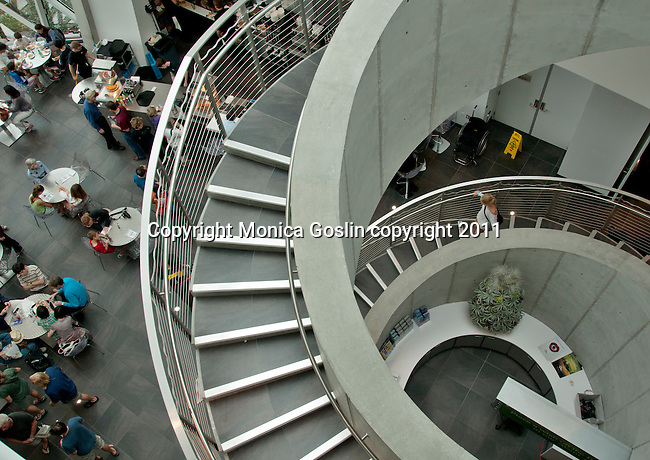 The cafe and the spiral staircase at the Dali Museum in St. Petersburgh, Florida which was designed by Yann Weymouth at HOK and opened in 2011; the museum was founded by A. Reynolds and Eleanor Morse who started collecting Dali paintings in 1943