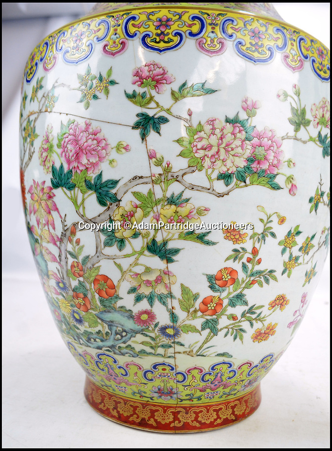 BNPS.co.uk (01202 558833)Pic: AdamPartridgeAuctioneers/BNPS<br /> <br /> A Chinese vase that was badly damaged from being used as a stick stand in an outdoor porch for over 40 years has sold for a staggering £110,000.<br /> <br /> The 26ins tall vase had large chunks missing from its rim and several cracks to its base, prompting experts to value it at just £200.<br /> <br /> But it turned out to have been made for a Chinese emperor in the early 19th century to display at one of his imperial palaces.