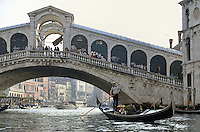 Gondola passing by the Rialto Bridge, Venice, Italy.