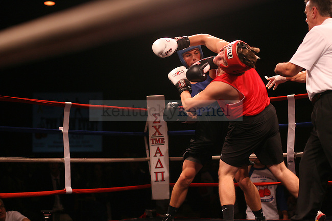 SAE's Steven Stickrod puts a knock out blow on John Reisig of Sigma Chi during the Main Event hosted by Alpha Delta Pi sorority and Sigma Chi fraternity at the Lexington Convention Center on Friday, November 21, 2014. Photo by Taylor Pence | Staff