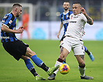 Milan Skriniar of Inter is challenged by Radja Nainggolan of Cagliari during the Coppa Italia match at Giuseppe Meazza, Milan. Picture date: 14th January 2020. Picture credit should read: Jonathan Moscrop/Sportimage