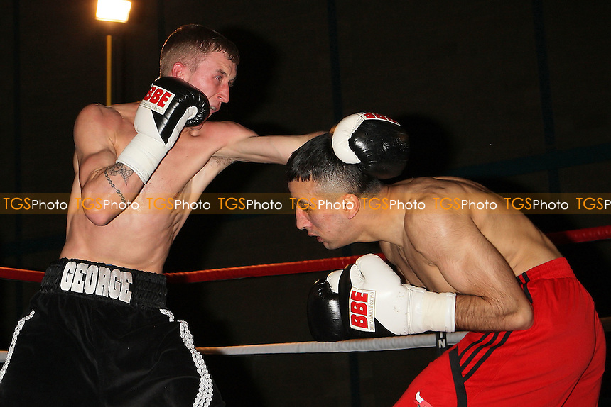 Raffi Khan (red shorts) defeats George Jupp in a Super-Featherweight boxing contest at Goresbrook Leisure Centre,Dagenham, promoted by Steve Goodwin - 19/03/11 - MANDATORY CREDIT: Gavin Ellis/TGSPHOTO - Self billing applies where appropriate - Tel: 0845 094 6026