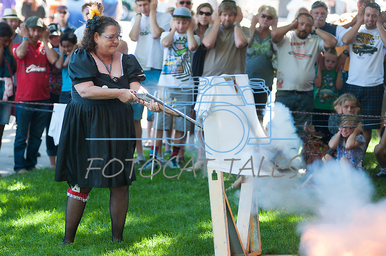 Autumn Hill from Badges, Bandits and Bloomers demos the dangers of a loaded gun during Legends of the West in Carson City, Nev., on Saturday June 22, 2013.<br /> (Photo by Kevin Clifford/Nevada Photo Source)