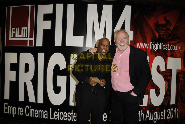 "DON WARRINGTON & JAMES COSMO.""The Glass Man"" Film4 Frightfest Day 2 world premiere arrivals, Empire cinema, Leicester Square, London, England..August 26th, 2011.half length black suit jacket pink shirt glasses beard facial hair.CAP/CAN.©Can Nguyen/Capital Pictures."