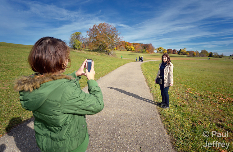 Sherin Ibrahim, 11, takes a photo of her sister Nesreen, 18, as they walk through the countryside outside Messstetten, Germany. The two Syrian refugees have applied for asylum in Germany and are awaiting word on the government's decision. Meanwhile, they live in a room in a former army barracks in Messstetten.