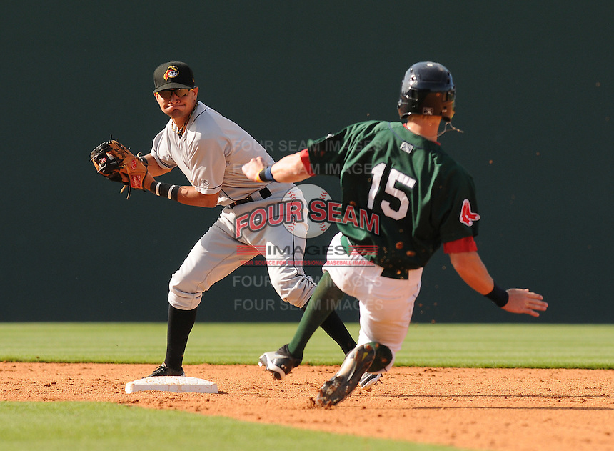 Second baseman Francisco Aponte (2) of the West Virginia Power turns the first half of a double play by tagging out Jordan Weems (15) of the Greenville Drive to end the fifth inning of a game on May 20, 2012, at Fluor Field at the West End in Greenville, South Carolina. Greenville won 6-5. (Tom Priddy/Four Seam Images)
