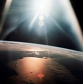 """In Earth Orbit - (FILE) -- The morning sun reflects on the Gulf of Mexico and the Atlantic Ocean as seen from the Apollo 7 spacecraft during its 134th revolution of the Earth on October 20, 1968.  This photo is part of the book """"Apollo: Through the Eyes of the Astronauts"""" published to commemorate the 40th anniversary of the first manned lunar landing on July 20, 1969..Credit: NASA via CNP"""