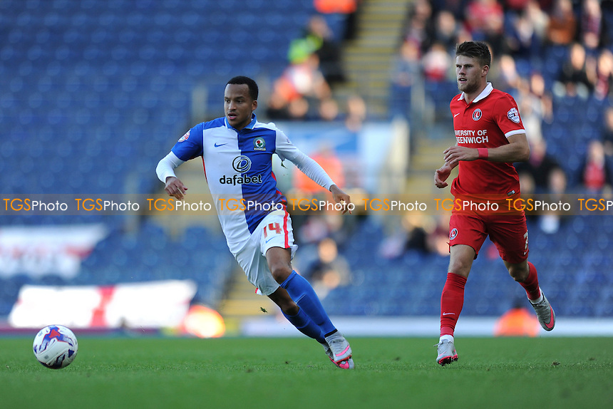 Marcus Olsson of Blackburn Rovers gets away from Johann Guomundsson of Charlton Athletic  during Blackburn Rovers vs Charlton Athletic, Sky Bet Championship Football at Ewood Park, Blackburn, England on 19/09/2015