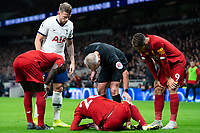 Referee Martin Atkins, Tottenham's Toby Alderweireld and teammates Roberto Firmino and Sadio Mane check on the injured Liverpool's Andy Robertson <br /> <br /> Photographer Stephanie Meek/CameraSport<br /> <br /> The Premier League - Tottenham Hotspur v Liverpool - Saturday 11th January 2020 - Tottenham Hotspur Stadium - London<br /> <br /> World Copyright © 2020 CameraSport. All rights reserved. 43 Linden Ave. Countesthorpe. Leicester. England. LE8 5PG - Tel: +44 (0) 116 277 4147 - admin@camerasport.com - www.camerasport.com
