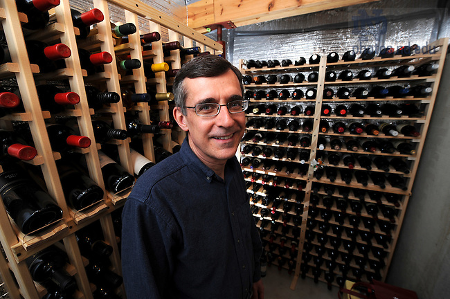 Warren Rees in his wine cellar in the basement of his Mishawaka home.
