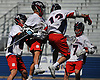 Will Giarraputo #33 of Cold Spring Harbor, second from left, gets congratulated by Brady Strough #12 and teammates after scoring the opening goal of the game in the Nassau County varsity boys lacrosse Class C semifinals against Floral Park at Shuart Stadium, located on the campus Hofstra University in Hempstead, on Thursday, May 24, 2018.