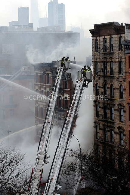 WWW.ACEPIXS.COM<br /> <br /> March 26 2015, New York City<br /> <br /> Firefighters battle a blaze caused by an explosion in a building on 2nd Avenue in the East Village of Manhattan on March 26 2015 in New York City<br /> <br /> By Line: Kristin Callahan/ACE Pictures<br /> <br /> <br /> ACE Pictures, Inc.<br /> tel: 646 769 0430<br /> Email: info@acepixs.com<br /> www.acepixs.com