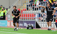 Lincoln City manager Danny Cowley, left, and Lincoln City's assistant manager Nicky Cowley shout instructions to his team from the technical area<br /> <br /> Photographer Chris Vaughan/CameraSport<br /> <br /> The EFL Sky Bet Championship - Rotherham United v Lincoln City - Saturday 10th August 2019 - New York Stadium - Rotherham<br /> <br /> World Copyright © 2019 CameraSport. All rights reserved. 43 Linden Ave. Countesthorpe. Leicester. England. LE8 5PG - Tel: +44 (0) 116 277 4147 - admin@camerasport.com - www.camerasport.com