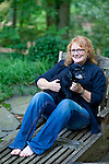 Emily Saliers, best known for being one half of the folk rock band the Indigo Girls, has a two-bedroom home in Decatur, Georgia, not far from her restaurant Watershed. Emily sits in her backyard with her dog Phoebe June 14, 2010...CREDIT: Kendrick Brinson/LUCEO.EmilySaliers