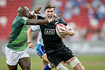 Sandile Ngcobo of South Africa (left) tries to stop Sam Dickson of New Zealand (right) during the match South Africa vs New Zealand, Day 2 of the HSBC Singapore Rugby Sevens as part of the World Rugby HSBC World Rugby Sevens Series 2016-17 at the National Stadium on 16 April 2017 in Singapore. Photo by Victor Fraile / Power Sport Images