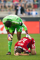 Chicago Fire goalkeeper Sean Johnson (25) checks on Logan Pause (12). The Chicago Fire defeated the Philadelphia Union 3-1 during a Major League Soccer (MLS) match at PPL Park in Chester, PA, on August 12, 2012.