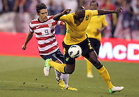 COLUMBUS, OHIO - SEPTEMBER 11, 2012:  Herculez Gomez (9) of the USA MNT challenges Nyron Nosworthy (2) of  Jamaica during a CONCACAF 2014 World Cup qualifying  match at Crew Stadium, in Columbus, Ohio on September 11. USA won 1-0.